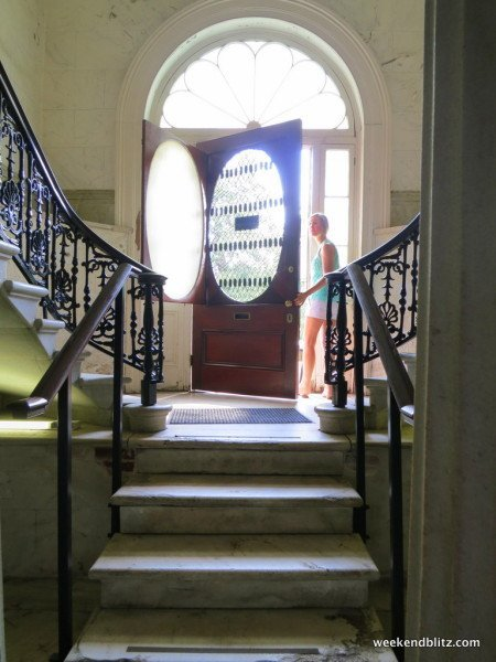 Entrance way: marble staircase down to gift shop and up to house