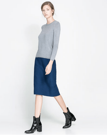 A neutral sweater you can pair with anything - leggings, shorts, skirts, jeans... http://www.zara.com/us/en/woman/knitwear/sweater-with-zip-at-the-back-c269190p1325111.html