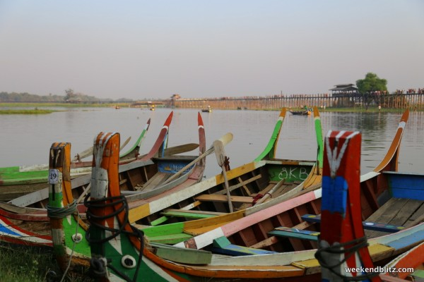 Colorful boats on the lake near U Bein Bridge